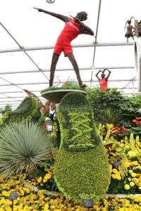 Usain bolt in wicker ontop of a flower shoe